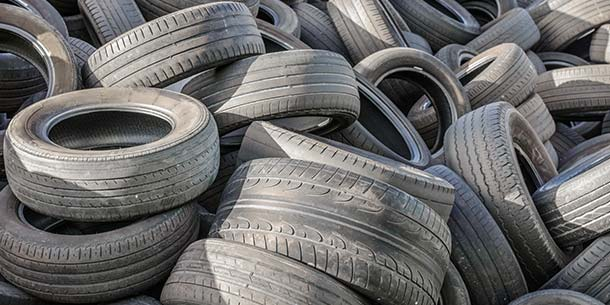 pile of used tyres for disposal