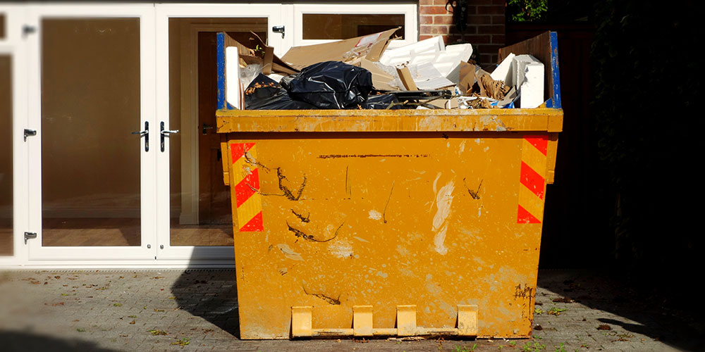 Large skip outside customer's home