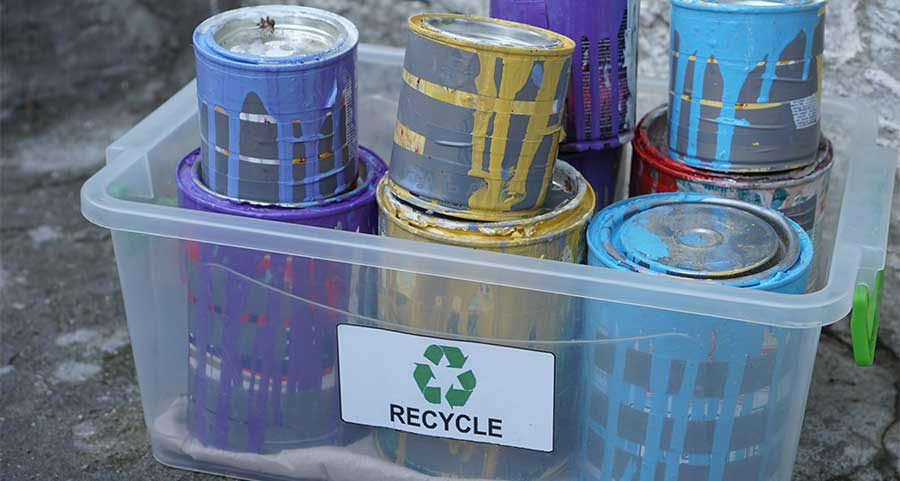 Paint Cans Being Recycled