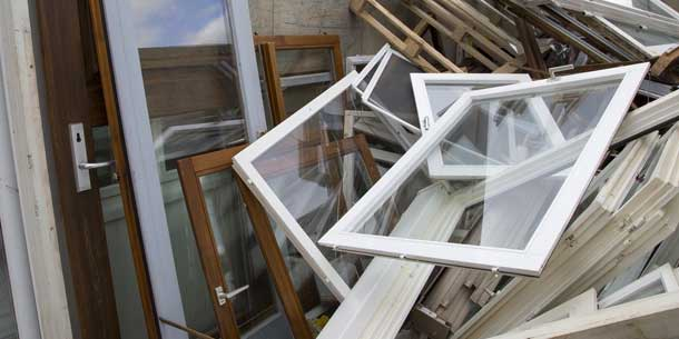 Large glass windows and panels in a skip