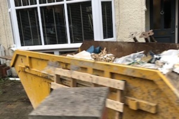 A skip being collected in Crowthorne, Berkshire