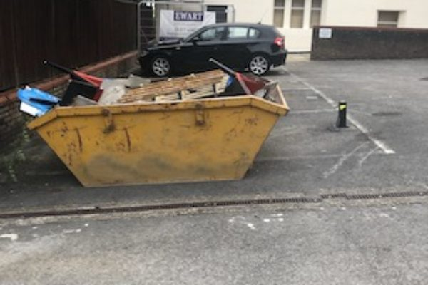 Skip in a Car Park in Woking, Surrey