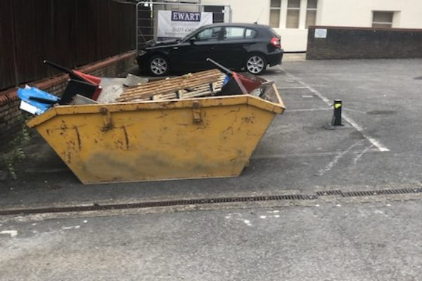 Skip in car park in Hotwells